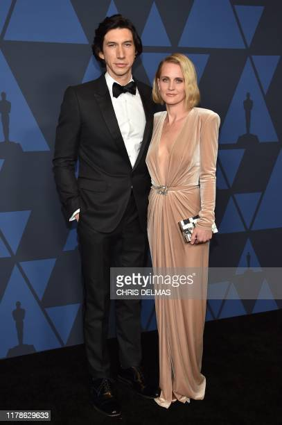 US actor Adam Driver and wife US actress Joanne Tucker arrive to attend the 11th Annual Governors Awards gala hosted by the Academy of Motion Picture...