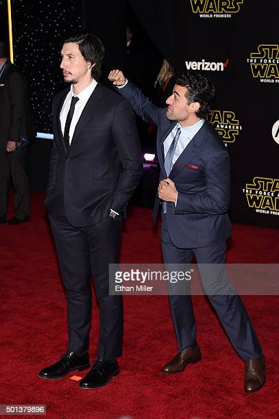 Actor Adam Driver is photobombed by actor Oscar Isaac as they attend the premiere of Walt Disney Pictures and Lucasfilm's Star Wars The Force Awakens...