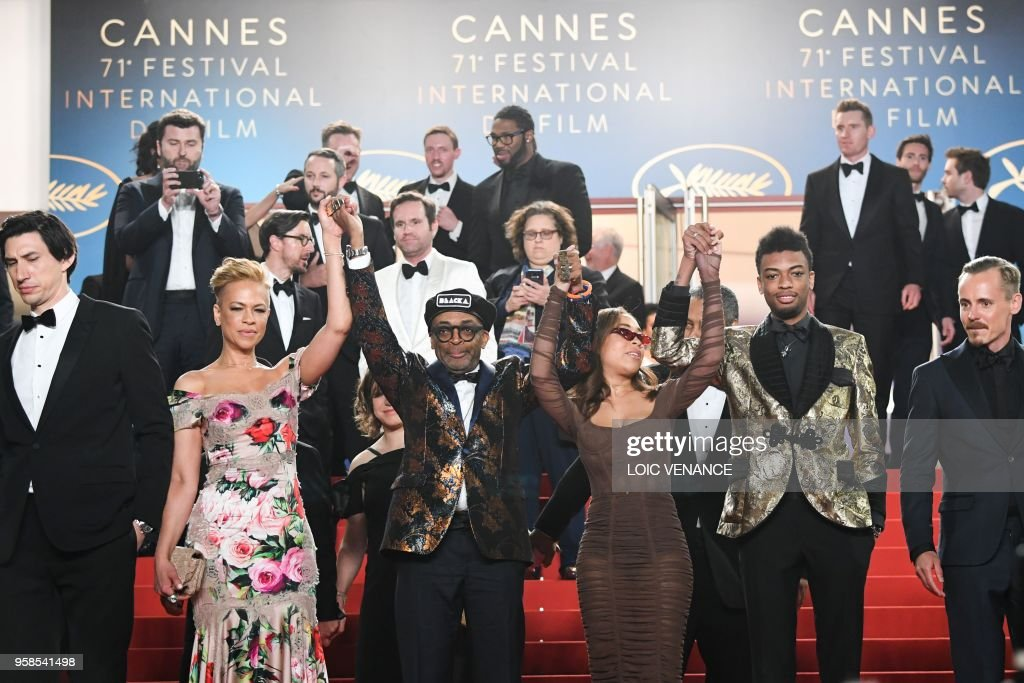 US actor Adam Driver (L), US director Spike Lee (3rdL), his wife Tonya Lewis Lee (2ndL), their children Satchel Lee (3rdR), Jackson Lee (2ndR) and Finnish actor Jasper Paakkonen (R) pose on May 14, 2018 while leaving following the screening of the film 'BlacKkKlansman' at the 71st edition of the Cannes Film Festival in Cannes, southern France.