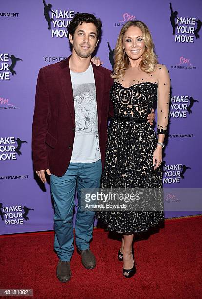 Actor Adam Garcia and dancer Kym Johnson arrive at the Los Angeles premiere of Make Your Move at Pacific Theaters at the Grove on March 31 2014 in...