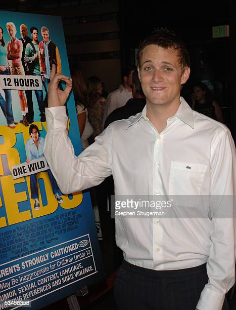 Actor Adam Grimes points to his picture on the movie's poster at the world premiere of Dirty Deeds at the Directors Guild of America on August 23...