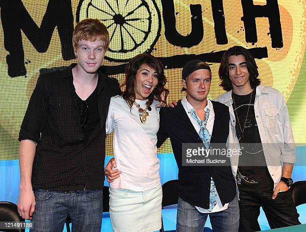 Actor Adam Hicks actress Hayley Kiyoko actor Chris Brochu and actor Blake Michael sign autographs at the D23 Expo 2011 at the Anaheim Convention...