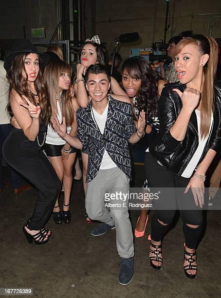 Actor Adam Irigoyen and Fifth Harmony members Lauren Jauregui, Ally Brooke, Camila Cabello, Normani Hamilton and Dinah Jane Hansen pose backstage at...