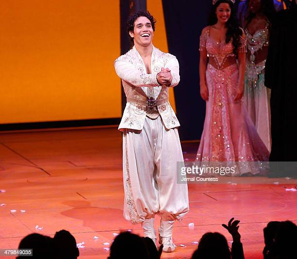 Actor Adam Jacobs takes a bow during curtain call at the the Aladdin On Broadway Opening Night at New Amsterdam Theatre on March 20 2014 in New York...