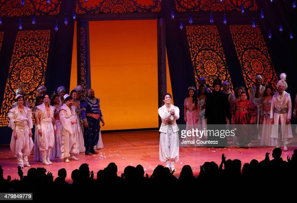 Actor Adam Jacobs takes a bow during curtain call at the the 'Aladdin' On Broadway Opening Night at New Amsterdam Theatre on March 20 2014 in New...
