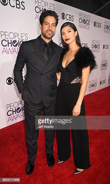 Actor Adam Rodriguez and Grace Gail attend the People's Choice Awards 2017 at Microsoft Theater on January 18 2017 in Los Angeles California