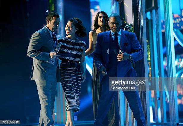 Actor Adam Sandler accepts the award for Favorite Comedic Movie Actor from actors Olivia Munn and Anthony Anderson onstage during The 41st Annual...