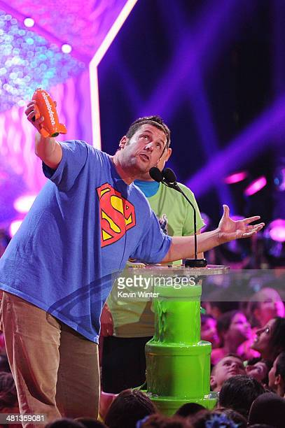 Actor Adam Sandler accepts the Favorite Movie Actor award for 'Grown Ups 2' onstage during Nickelodeon's 27th Annual Kids' Choice Awards held at USC...