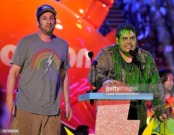 Actor Adam Sandler and actor Josh Gad after getting slimed onstage during Nickelodeon's 28th Annual Kids' Choice Awards held at The Forum on March 28...