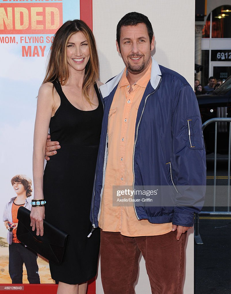 Actor Adam Sandler (R) and Jackie Sandler arrive at the Los Angeles premiere of 'Blended' at TCL Chinese Theatre on May 21, 2014 in Hollywood, California.