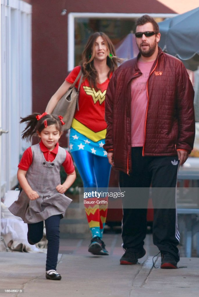 Actor Adam Sandler and Jackie Sandler with daughter Sunny are seen on October 31, 2013 in Los Angeles, California.