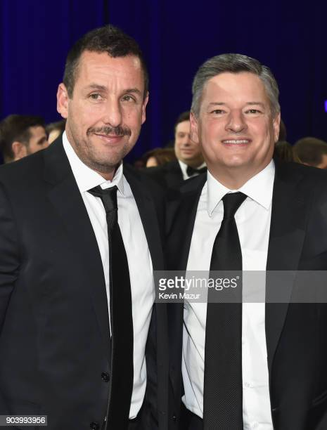 Actor Adam Sandler and Netflix Chief Content Officer Ted Sarandos attend The 23rd Annual Critics' Choice Awards at Barker Hangar on January 11 2018...