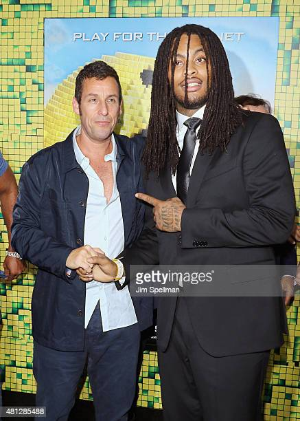 Actor Adam Sandler and rapper Waka Flocka Flame attend the Pixels New York premiere at Regal EWalk on July 18 2015 in New York City