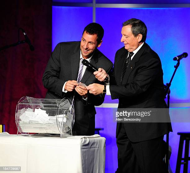 Actor Adam Sandler and Tom Sherak announce a raffle winner of a car at the Fulfillment Fund Stars Gala at The Beverly Hilton Hotel on October 24 2012...