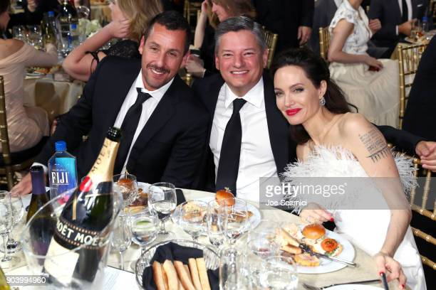 Actor Adam Sandler businessman Ted Sarandos and actor Angelina Jolie attend the 23rd Annual Critics' Choice Awards on January 11 2018 in Santa Monica...