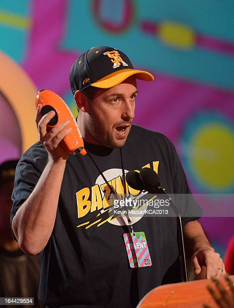 Actor Adam Sandler performs during Nickelodeon's 26th Annual Kids' Choice Awards at USC Galen Center on March 23 2013 in Los Angeles California
