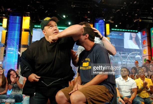 Actor Adam Sandler sniffs Actor Kevin James's armpit to see if he can differentiate between his and Jessicsa Biel's armpit as MTV VJ Damien Fahey...