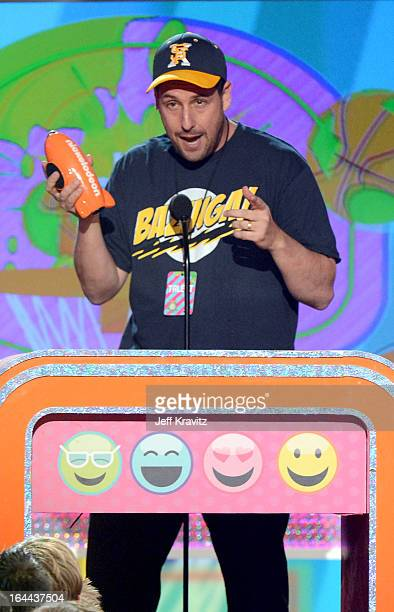Actor Adam Sandler speaks onstage at Nickelodeon's 26th Annual Kids' Choice Awards at USC Galen Center on March 23 2013 in Los Angeles California