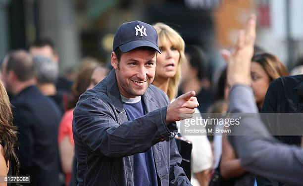 Actor Adam Sandler speaks to a fan during the 'You Don't Mess With The Zohan' film premiere at Grauman's Chinese Theatre on May 28 2008 in Hollywood...