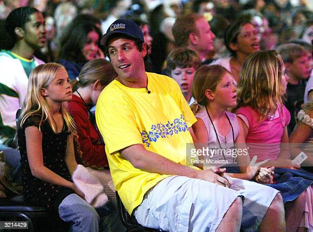 Actor Adam Sandler watches Nickelodeon's 17th Annual Kids' Choice Awards at Pauley Pavilion on the campus of UCLA April 3 2004 in Westwood California