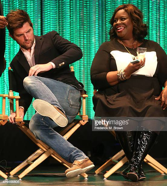 Actor Adam Scott and actress Retta speak during The Paley Center for Media's PaleyFest 2014 Honoring 'Parks and Recreation' at the Dolby Theatre on...