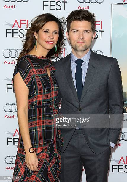 Actor Adam Scott and his wife Naomi Sablan attend The Secret Life Of Walter Mitty premiere at AFI FEST 2013 at TCL Chinese Theatre on November 13...