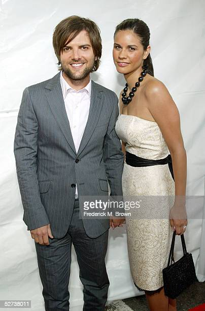 Actor Adam Scott and Naomi Sablan arrive at New Line Cinema's Premiere of Monster In Law at the Mann National Theatre on April 29 2005 in Westwood...