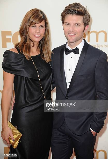 Actor Adam Scott and Naomi Sablan arrive at the 63rd Primetime Emmy Awards at Nokia Theatre LA Live on September 18 2011 in Los Angeles California
