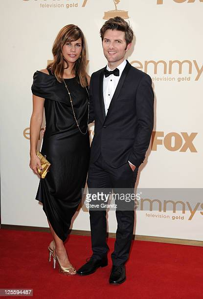 Actor Adam Scott and Naomi Sablan arrive to the 63rd Primetime Emmy Awards at the Nokia Theatre LA Live on September 18 2011 in Los Angeles United...