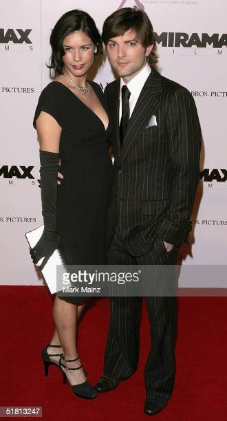 Actor Adam Scott and Naomi Sablan attends the premiere of The Aviator at Mann's Chinese Theatre on December 1 2004 in Hollywood California