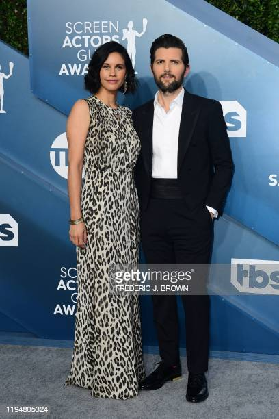 US actor Adam Scott and wife Naomi Sablan arrive for the 26th Annual Screen Actors Guild Awards at the Shrine Auditorium in Los Angeles on January 19...