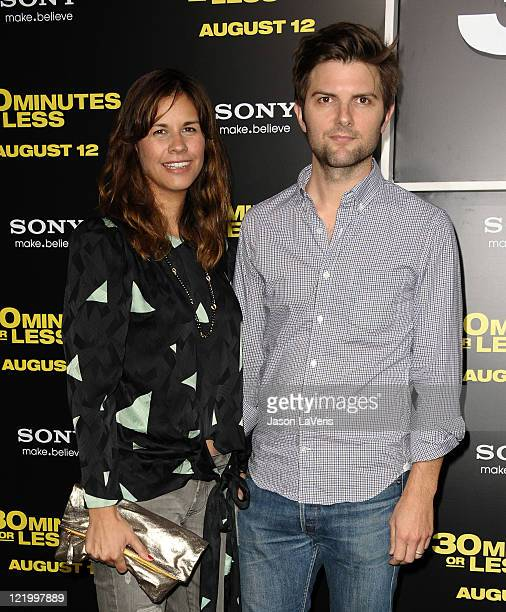 Actor Adam Scott and wife Naomi Sablan attend the premiere of 30 Minutes or Less at Grauman's Chinese Theatre on August 8 2011 in Hollywood California