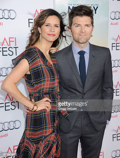 Actor Adam Scott and wife Naomi Scott arrive at AFI FEST 2013 'The Secret Life Of Walter Mitty' premiere at TCL Chinese Theatre on November 13 2013...