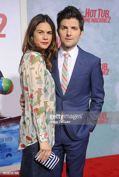 Actor Adam Scott and wife Naomi Scott arrive at the Los Angeles premiere of 'Hot Tub Time Machine 2' at Regency Village Theatre on February 18 2015...