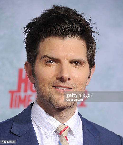 Actor Adam Scott arrives at the Los Angeles premiere of 'Hot Tub Time Machine 2' at Regency Village Theatre on February 18 2015 in Westwood California