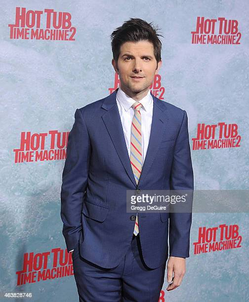 Actor Adam Scott arrives at the Los Angeles premiere of Hot Tub Time Machine 2 at Regency Village Theatre on February 18 2015 in Westwood California