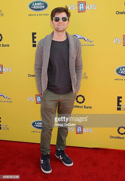 Actor Adam Scott arrives at the PS ARTS Express Yourself 2014 at The Barker Hanger on November 16 2014 in Santa Monica California