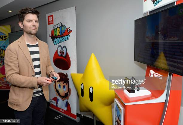 Actor Adam Scott from the television series 'Ghosted' stopped by Nintendo at the TV Insider Lounge to check out Nintendo Switch during ComicCon...