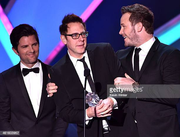 Actor Adam Scott presents the Best Action Movie award to director/writer James Gunn and actor Chris Pratt for 'Guardians of the Galaxy' onstage...
