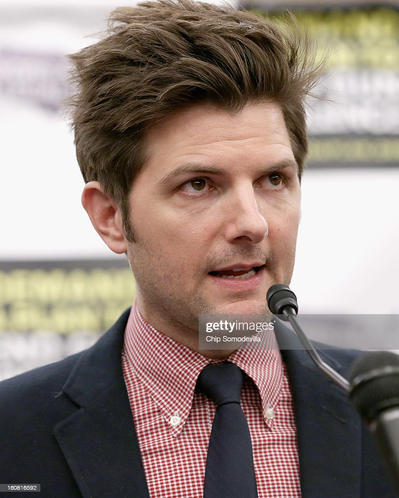 Actor Adam Scott speaks during a news conference hosted by the Mayors Against Illegal Guns and the Law Center to Prevent Gun Violence at the U.S. Capitol February 6, 2013 in Washington, DC. The artists, activists and politicians called for manditory background check on all gun purchases among other restrictions.