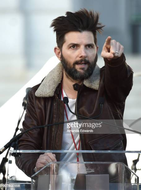 Actor Adam Scott speaks onstage at 2018 Women's March Los Angeles at Pershing Square on January 20 2018 in Los Angeles California
