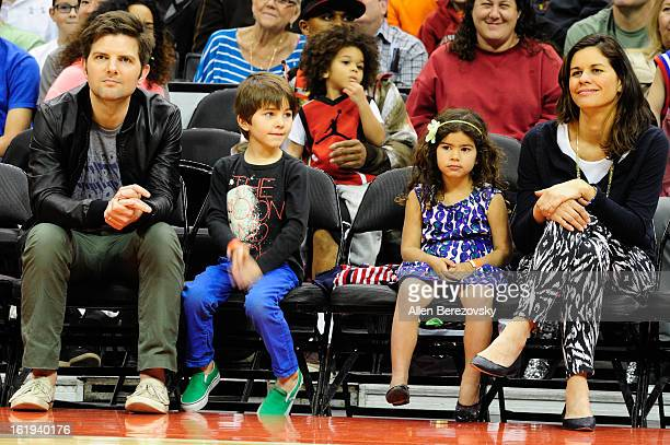 Actor Adam Scott wife Niomi Scott and their children attend the Harlem Globetrotters You Write The Rules 2013 tour game at Staples Center on February...