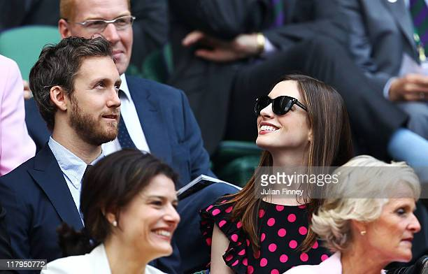 Actor Adam Shulman and actress Anne Hathaway attend the Ladies' final round match between Maria Sharapova of Russia and Petra Kvitova of the Czech...