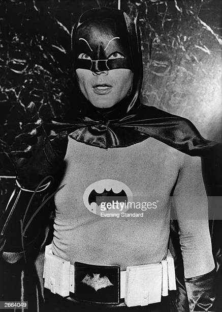 Actor Adam West in his role as masked superhero Batman