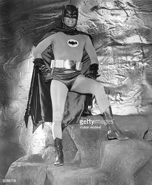 Actor Adam West wears his Batman costume in the Batcave in a fulllength promotional portrait for the television series 'Batman'