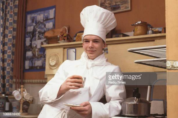 Actor Adam Woodyatt wearing chef's whites pictured on the set of the BBC soap opera 'EastEnders' January 9th 1985