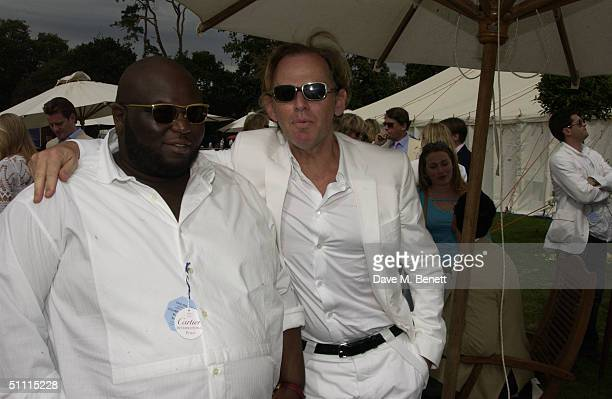 Actor Ade and Designer David Collins attend Cartier International Day held at Guards Polo Club Windsor Great Park on July 25 2004 in Windsor England