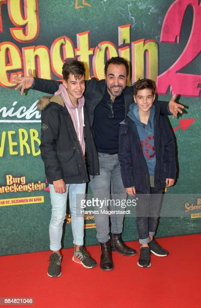 Actor Adnan Maral and his sons Can and Acun during the 'Burg Schreckenstein 2' Premiere at Mathaeser Filmpalast on December 3 2017 in Munich Germany