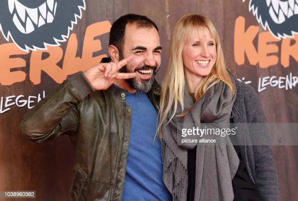 Actor Adnan Maral and his wife Franziska arrive for the premier of 'Die Wilden Kerledie Legende lebt' in Munich Germany 31 January 2016 The film...