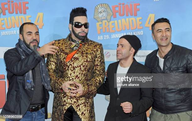 Actor Adnan Maral designer Harald Gloeoeckler director Mike Marzuk and the actor Mehmet Kurtulus pose in front of the movie poster at the premiere of...